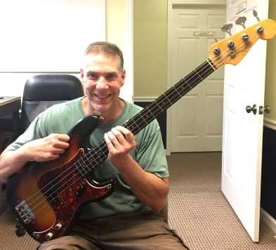 Artisan Luthiers customer Kyle Pearson with a newly serviced 1962 Fender Precision bass.