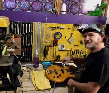 Guitar repair shop tech working on a Gibson Les Paul 50's Tribute gold top guitar