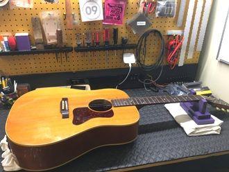 Acoustic guitar wiring repair, electrical repair and parts replacement.