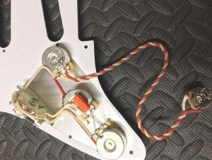 Guitar wiring repair, electrical repair and parts replacement.
